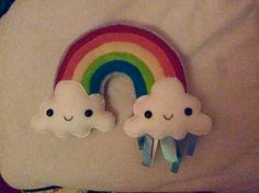 Felt rainbow plushie with ribbon tags and rattle inside cloud. Adapted from design by imanufatti https://www.etsy.com/uk/listing/191841324/pdf-pattern-rainbow-and-clouds-baby-crib