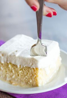 Tres Leches Cake - A simple recipe (no whipping egg whites!) for a super moist cake with the best whipped cream topping!