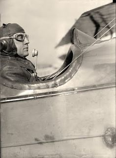 This is a picture of Clarence Culver at the controls of a biplane. Clarence was in the army, and was in charge of getting radios to work in airplanes. Note the microphone in the picture. I would think wind noise would be a little bit of an issue in an open cockpit airplane like this.