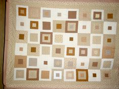 Scrappy quilt in taupes...