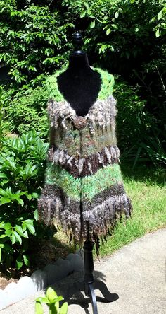 A personal favorite from my Etsy shop https://www.etsy.com/listing/398604991/art-yarn-knitted-poncho
