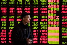 An investor observes stock market at a stock exchange corporation