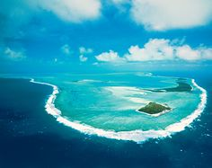 """This 11-night odyssey showcases the region's incredible diversity of scenery, from Aitutaki's low-lying islands to the jagged peaks and deep valleys of fertile Rarotonga, which was simply called """"Paradise"""" by the first European explorers. Continue to the Society Islands to delight in the South Pacific's crown jewels—Bora Bora, Taha'a, Huahine, and Moorea."""