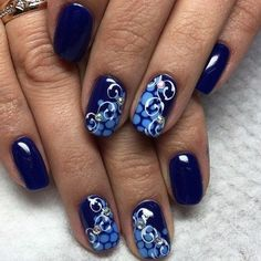 The Blue Studded Nail Art. The polka dotted base, white pattern over and studs all across makes the best blue nail art design for you.