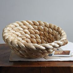 @Melissa Hornby You can do this! Rope from hardware store, and put it on the entry table for keys and random mail. Grownup Nautical!
