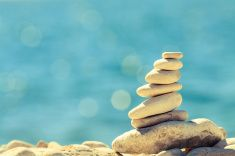 Stones pebbles balance at the beach, stack over blue sea stock photo 72693099 - iStock