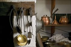 colonial cooking utensils | Utensils made of copper, brass, tin, and iron hang from the lintel of ...