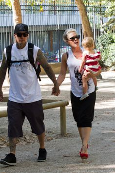 PARIS, FRANCE - SEPTEMBER 09: Singer Pink, her husband Carey Hart and their baby Willow Sage Hart are seen in the 'Jardins du Luxembourg' on September...