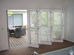 Over Family Room Sliding Glass Door: Plantation Shutters.