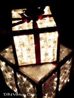 DIY these trendy holiday decorations with some wood, outdoor lights, and ribbon. Once you create the boxes in your desired dimensions, stuff some Christmas lights inside and wrap the exterior.