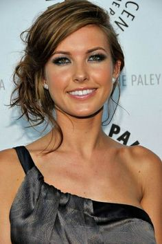 Love the brown hair highlights with the one shoulder top!