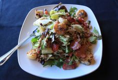 Firebird Wood Fired Grill in Moorestown, N.J. makes a delicious grilled shrimp and strawberry salad, it includes mixed greens, goat cheese, jicama, and roasted pecans, tossed in a balsamic vinaigrette (Calista Condo/South Jersey Times).