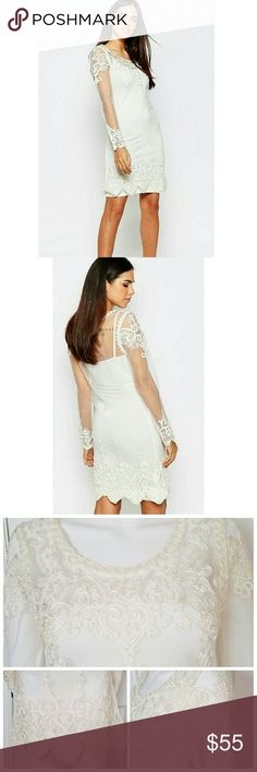 NWT gorgeous mesh embroidered cream dress Color is a little more cream than Ivory in my opinion. Has a slip dress with the full mesh embroidered overlay dress. Labeled size 0. Looks to run up one size larger (so a 2) but I will add measurement shortly. NO TRADES Club L Dresses