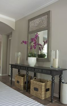 I love HomeGoods selection of faux flowers.  I used the magenta orchid for a clients entry- and everyone thinks its real.