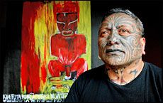 Tame Iti with one of the works in Lest We Forget . He says the use of words in art is rooted in Tuhoe tradition. Picture / Kenny Rodger