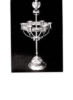 Gustav Gaudernack design for David Andersen. Six candle candelabra in silver with fruit pattern and owl handle. ca 1908. Present localization unknown.