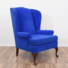 This wingback chair is upholstered in a durable velvet with a vibrant electric blue finish. This armchair is in great condition with a tall wingback, dark solid wood cabriole legs and curved arms. Comfortable and elegant chair perfect for a sitting room! #traditional #chairs #armchair #sandiegovintage #vintagefurniture