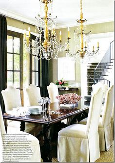 I'm crazy over its dining room – so wonderful because of this gorgeous pair of chandeliers!! 18th century French.  Stunning!!