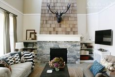 jdc-living-room-with-shingled-fireplace-antlers.  Love Jones Design Co, one of my favorite design bloggers