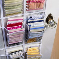 Have bits of ribbon and trims stashed in places you can't see? Wind them around uniform-size cards and store them in a pocketed, over-the-door hanger meant to hold shoes or toiletries.