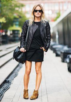 Black leather jacket, black t-shirt, black skirt, and leopard print ankle boots