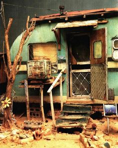 "Vintage Camper. Rustic or rusty? ""These scream hovel on the cheap and can be relocated."""