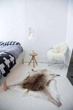 I have loved this scandanavian bedroom ever since I first saw it posted.  That wool blanket is wonderful.