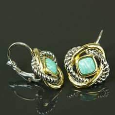 Cute turquoise color earrings with silver & gold tone trim....$16.99