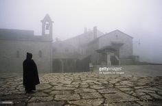 Stock Photo : View through fog of Sanctuary of La Verna, Where St Francis received stigmata in 1224, Chiusi della Verna, National Park of Casentino Forests, Mount Falterona and Campigna, Tuscany, Italy