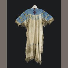A Plateau or Northern Plains beaded dress - A two-hide example heavily beaded across the bodice, short fringe along the perimeter, trailing bugle beaded strands.
