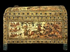 Painted box found in Tutankhamun's tomb and decorated with scenes of the Pharaoh leading his army middle eastern and Nubian armies. On this side he is firing arrows from his chariot. In another scene he is shown crushing the enemy soldiers under his heel and on the lid he is shown hunting animals including gazelle, hartebeast, ostrich, lion, and hyena. When Howard Carter found it in 1922 he described it as one of the greatest artistic treasures in the tomb.