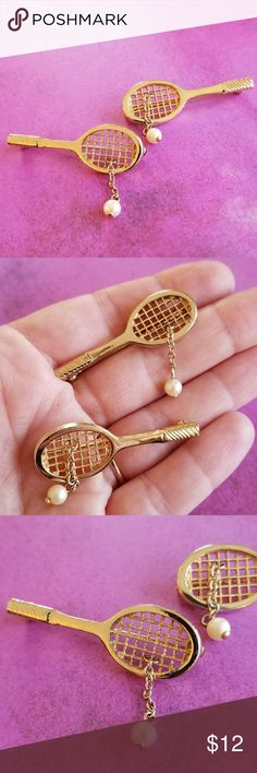 """Vtg Tennis Raquet brooch set by Avon pearl gold This super cute set of 2 pins are shaped like tennis racquets, each with a white faux pearl dangle """"ball"""". They are both signed AVON on the backs. These pins are in great shape and from a smoke free home:)  MoonG8898ball9f7f Vintage Jewelry Brooches"""