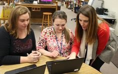COACHING IN TENNESSEE—At Whitthorne Middle School in Maury County Schools, data coach Rachel McMahon, on right, helps science and math teacher Chelsey Shepard, middle, and math teacher Amy Brewer improve teaching.
