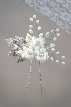 Bridal hair pin made of freshwater pearl and rhinestone bridal with silver leaves, a beautiful wedding hairstyle accessory.