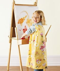 Pillowcase art smocks: Cut out holes for the head and arms. Gather the fabric between the neck hole and each armhole and tie with a ribbon for a better fit.