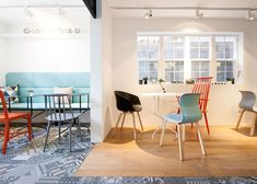 Cafe with a yellow house facade by Nordic Bros. Design Community,About A Chair, J110,J77 from HAY