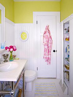 Makeover 1: Country Charm-To stretch the space and add interest to the bright white room, the homeowner installed head-high wainscoting and topped the wall with a warm, happy shade of greenish gold.        DIY Tip: Add architectural interest to a bright white space by using contrasting hardware on doors and cabinets.