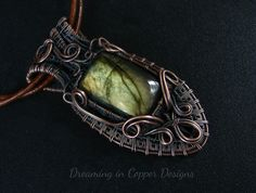 Gorgeous green labradorite wrapped in copper  by Dreaming in Copper Designs