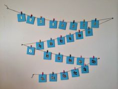 rukristin creates a DIY advent calendar using envelopes, chipboard numbers, and clothespins. This mini-envelope project is perfect for all.