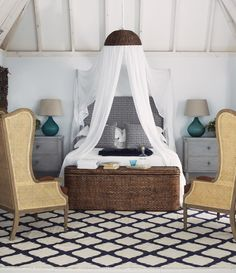Great use of a pendant lamp cover and a mosquito net! Oka again.