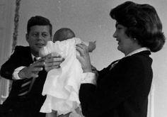 Jackie hands Caroline off to Jack, March 1958.