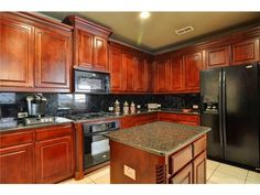 Brown and black kitchen