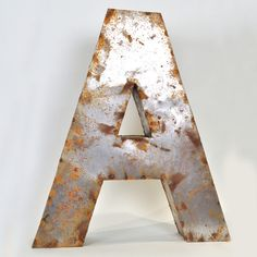 Reclaimed tin letters