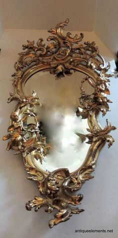 Extraordinary 19th Century French Carved & Gilt Cherub Rococo Mirror | From a unique collection of antique and modern mantel mirrors and fireplace mirrors at https://www.1stdibs.com/furniture/mirrors/mantel-mirrors-fireplace-mirrors/