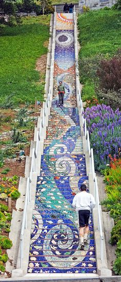 The 16th Avenue Tiled Steps project has been a neighborhood effort to create a beautiful mosaic running up the risers of the 163 steps located at 16th and Moraga in San Francisco. Sponsored by the San Francisco Parks Trust, artists Aileen Barr and Colette Crutcher started working on the project in January 2003. The mosaic staircase was completed on August 18, 2004 with the help of over 300 neighbours and over 220 neighbors, who sponsored handmade
