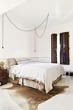 love the swagged light cord sets as an alternative to dual nightstand lights. // neutral + global
