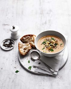 A whole bulb of roasted garlic adds incredible flavour to this smooth, cheesy soup and the topping of roasted cauliflower and stilton takes this simple lunch to a new level. Roasted Cauliflower, Roasted Garlic, Christmas Soup, Soup Recipes, Healthy Recipes, Good Food, Yummy Food, Delicious Magazine, Gourmet