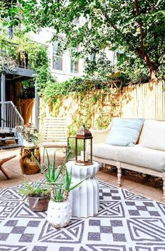 bright yet cozy patio with high walls - Patio Rugs