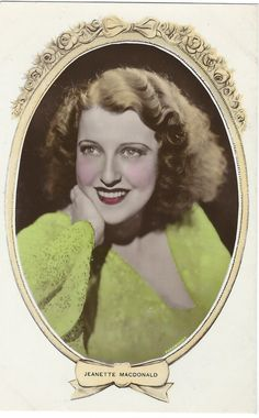 High resolution scan of a vintage, tinted postcard photo of Jeanette MacDonald. - ESCANO COLLECTION