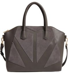 Faux-suede patches set in an arresting geometric pattern detail this smooth faux-leather satchel topped with rolled handles and an optional, adjustable shoulder strap.